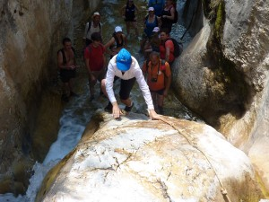 Clambering over rocks on the river Higuerón