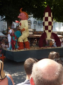 Tintin & Co. in Bagnères de Luchon. The floats are extensively decorated with flowers
