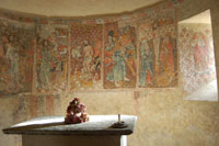 Wall paintings in the apse of the church at Benque-Dessus showing scenes from the crucifixion